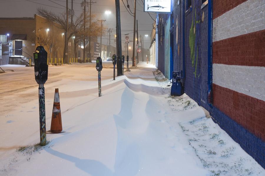 Dallas sidewalk covered in snow.